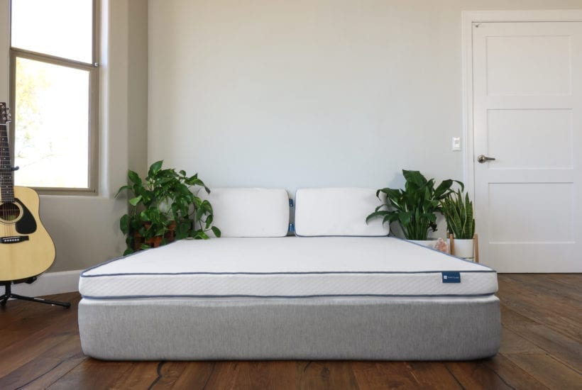 Nestled organic latex mattress topper in a bedroom