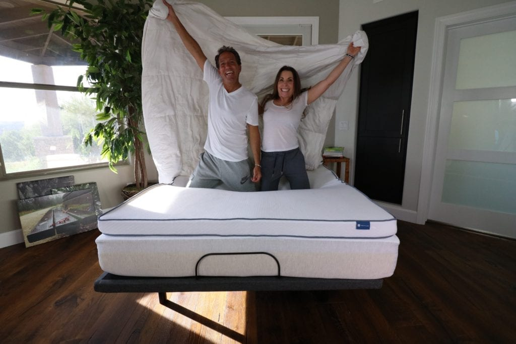 A happy couple with their Nestled organic latex mattress topper