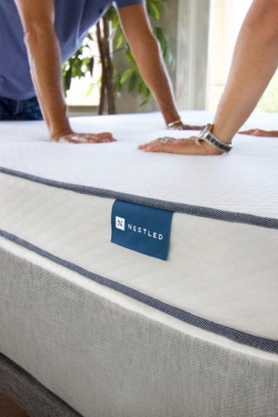 Testing the spring on a Nestled organic latex mattress topper