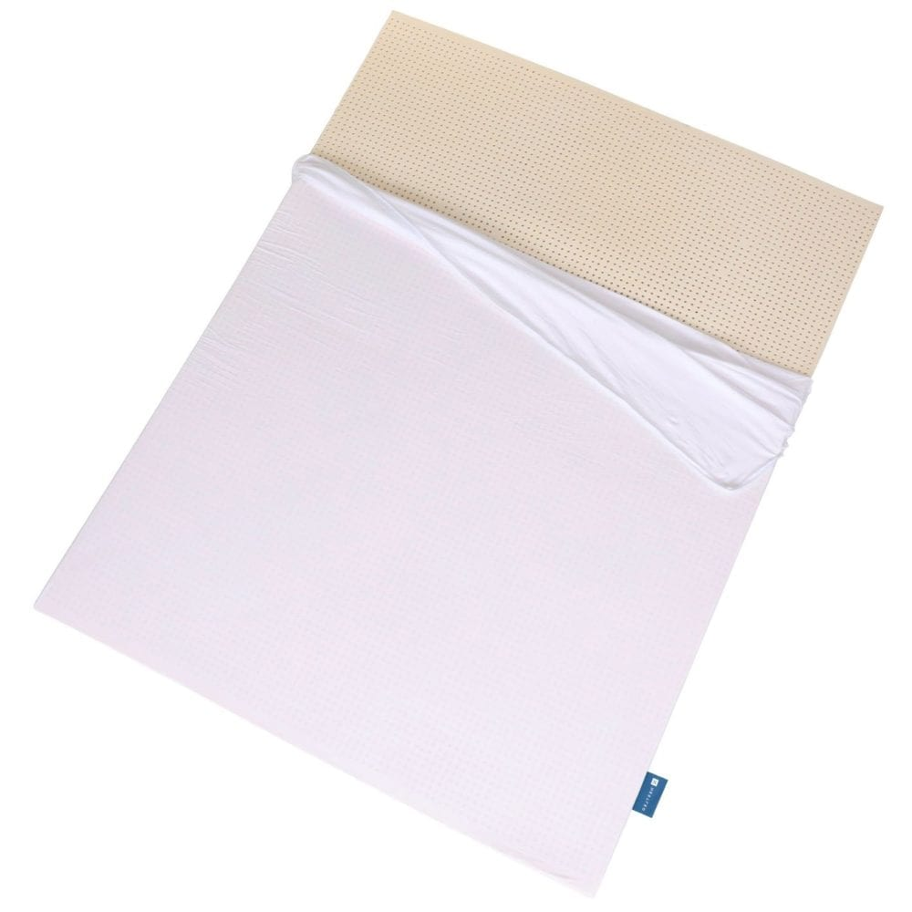 Naturally Nestled organic latex mattress topper with naturally latex exposed.