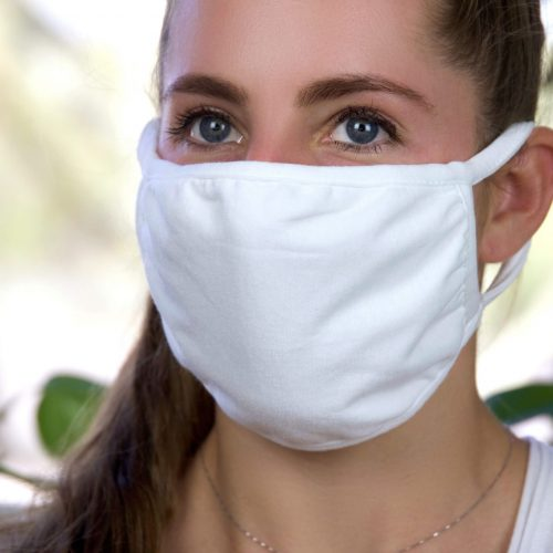 Naturally Nestled mask covering on a woman's face.